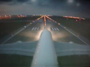 The best bit, for me, was the tail camera, which allows you to see a top view of your plane. This is take-off at dusk in KL.