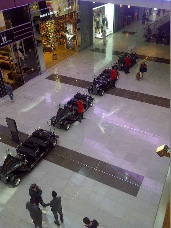 No, not Dubai Motor Show or even last week's vintage care parade, but Dubai Mall, which is so big a fleet of Rolls Royce-styled golf buggies is on hand to drive the podiatrically challenged from Gucci to Prada