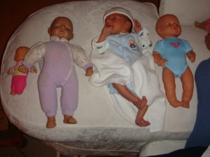 DS, when born, was tiny but perfect. Here he is, a week or two old, between two little ELC dolls...